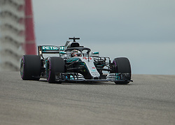 October 20, 2018 - Austin, USA - Mercedes AMG Petronas driver Lewis Hamilton (44) of Great Britain comes over the hill at Turn 10 during qualifying at the Formula 1 U.S. Grand Prix at the Circuit of the Americas in Austin, Texas on Saturday, Oct. 20, 2018. Hamilton set a new track record and earned pole position for the Grand Prix on Sunday. (Credit Image: © Scott Coleman/ZUMA Wire)