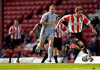 Photo: Alan Crowhurst.<br />Brentford v Bradford City. Coca Cola League 1. 08/04/2006. Brentford's Paul Brooker attacks.