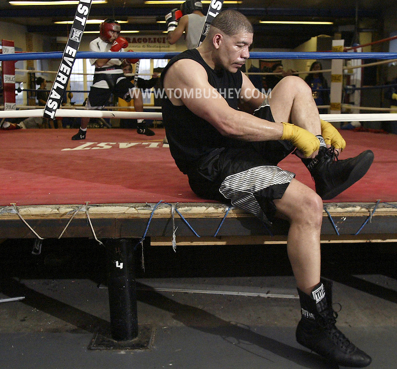 Dewey Bozella of Newburgh sits on the ring after sparring at the Newburgh Boxing Club on Wednesday, April 13, 2011.