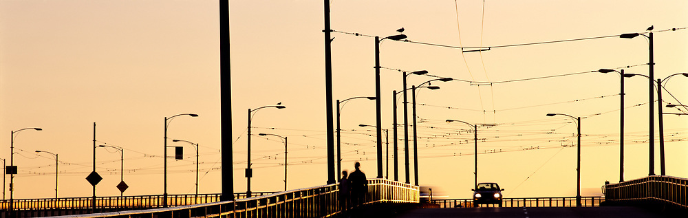 Granville Bridge, power lines, pedestrians and car at sunset