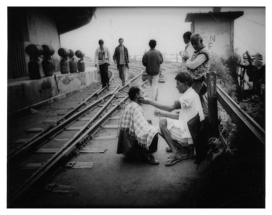 Getting a shave beside the Darjeeling Railway tracks, Ghoom.