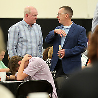 Rudy Dossett III and Scott Floyd, of Tupelo, take time to talk before the start of theDaily Journal's Reader's Choice Awards Thursday night at Building V of the Tupelo Furniture Market.