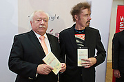 "Vienna, Austria.<br /> Vienna Mayor Dr. Michael Häupl (l.) and T.C. Boyle striking a pose for the press.<br /> ""Eine Stadt, ein Buch (one city, one book)"" opening ceremony  at the Hauptbücherei (main library), Urban-Loritz-Platz.<br /> As every year since 2002, the city of Vienna in cooperation with various sponsors gives away 100.000 free copies of a book by a world class author, this time ""América"" (The Tortilla Curtain) by American author T.C. Boyle.<br />