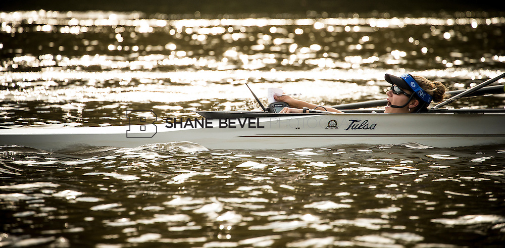 Angela Metzler, coxswain at the University of Tulsa leads her team on the waters of the Verdigris River.