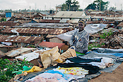 Woman selling clothes in Kibera slum, Kenya