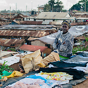 Woman selling clothes in Kibera slum, Kenya