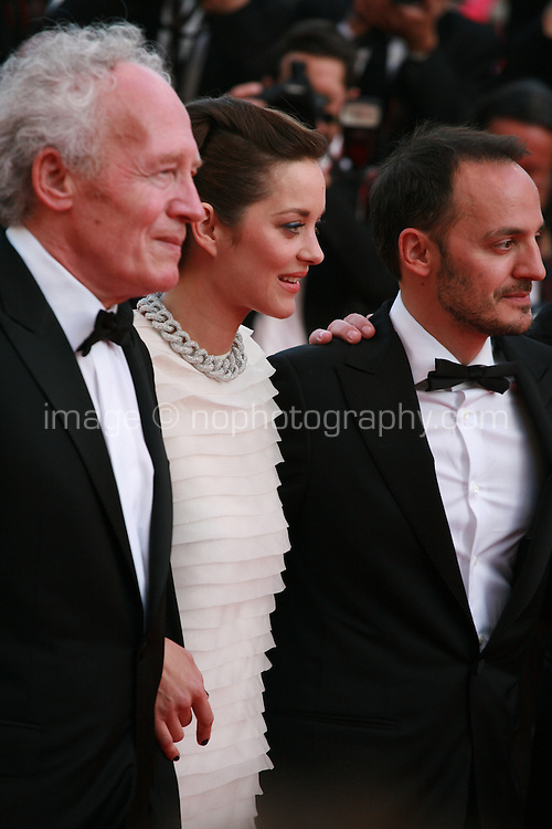 Jean-Pierre Dardenne, Marion Cotillard, Fabrizio Rongione at the Two Days, One Night (Deux Jours, Une Nuit) gala screening red carpet at the 67th Cannes Film Festival France. Tuesday 20th May 2014 in Cannes Film Festival, France.