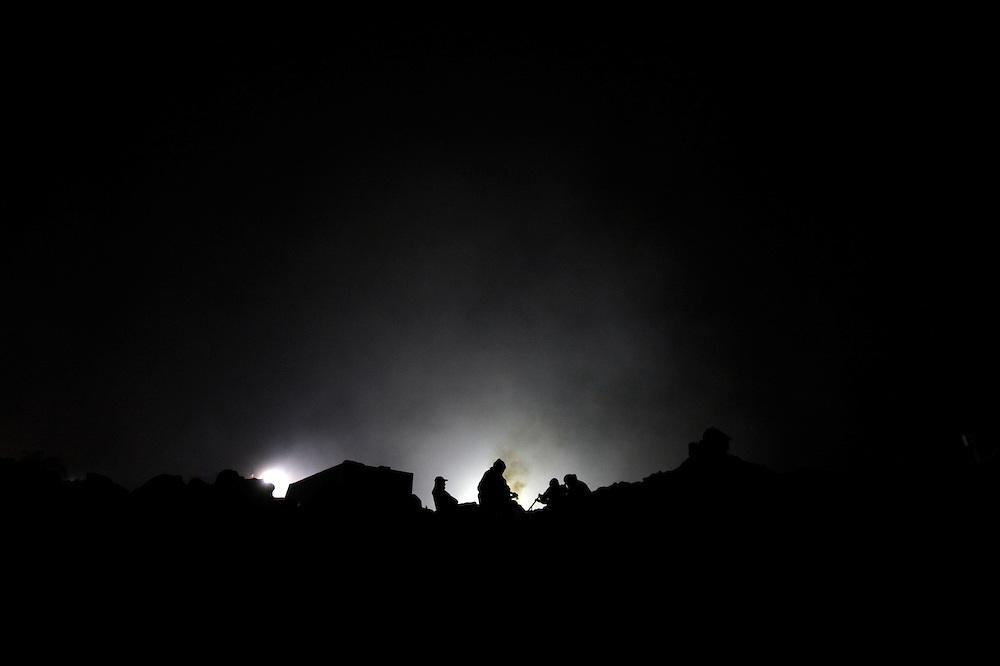 Relatives of 33 miners trapped in a gold and copper mine, sing and play guitar while waiting for news, August 14, 2010. They still do not know the miners are alive.<br /> <br /> Familiares de 33 mineros atrapados en una mina de oro y cobre, cantan y tocan guitarras a la espera de noticias, el 14 de agosto 2010. Ellos aun no saben que los mineros estan con vida.