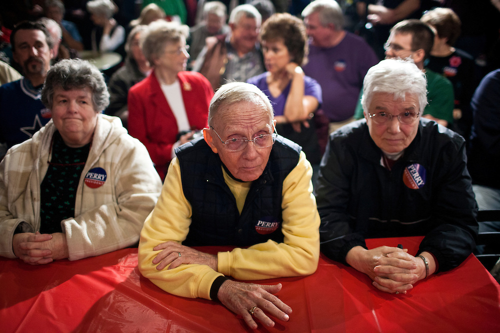 People wait for Republican presidential candidate Rick Perry to speak at the Fainting Goat on Friday, December 30, 2011 in Waverly, IA.