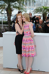 Australian actress Mia Wasikowska and US actress Jessica Chastain (R) poses during the photocall of 'Lawless' presented in competition at the 65th Cannes film festival on May 19, 2012 in Cannes..Photo Ki Price/i-Images