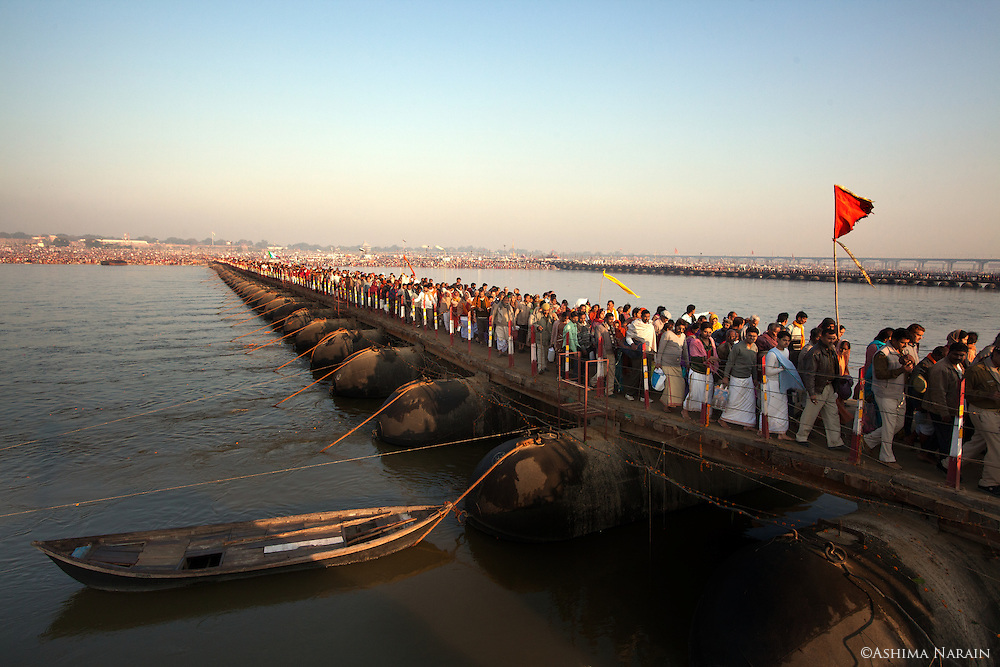 Maha Kumbh Mela, Allahbad, Morning of the full moon, Maghi Purnima Snan on 25th February 2013. An estimated 18 million people visited the Kumbh Mela that day. Pontoon Bridges allowed people to cross the river.