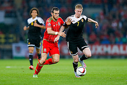 Gareth Bale of Wales (Real Madrid) and Kevin De Bruyne of Belgium (Wolfsburg) compete for the ball - Photo mandatory by-line: Rogan Thomson/JMP - 07966 386802 - 12/06/2015 - SPORT - FOOTBALL - Cardiff, Wales - Cardiff City Stadium - Wales v Belgium - EURO 2016 Qualifier.
