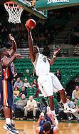 Nov 27, 2011; Birmingham, AL, USA;  UAB Blazers forward Ovie Soko (0) shoots under UT Martin Skyhawks forward Myles Taylor (33) at Bartow Arena.  Mandatory Credit: Marvin Gentry-US PRESSWIRE
