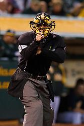 April 9, 2012; Oakland, CA, USA; MLB umpire James Hoye (92) calls a strike during the sixth inning between the Oakland Athletics and the Kansas City Royals at O.co Coliseum.  Oakland defeated Kansas City 1-0. Mandatory Credit: Jason O. Watson-US PRESSWIRE