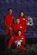 Biosphere 2 Project undertaken by Space Biosphere Ventures, a private ecological research firm funded by Edward P. Bass of Texas.  Four Biosphere 2 project candidates with a little goat.   Biosphere 2 was a privately funded experiment, designed to investigate the way in which humans interact with a small self-sufficient ecological environment, and to look at possibilities for future planetary colonization. 1990