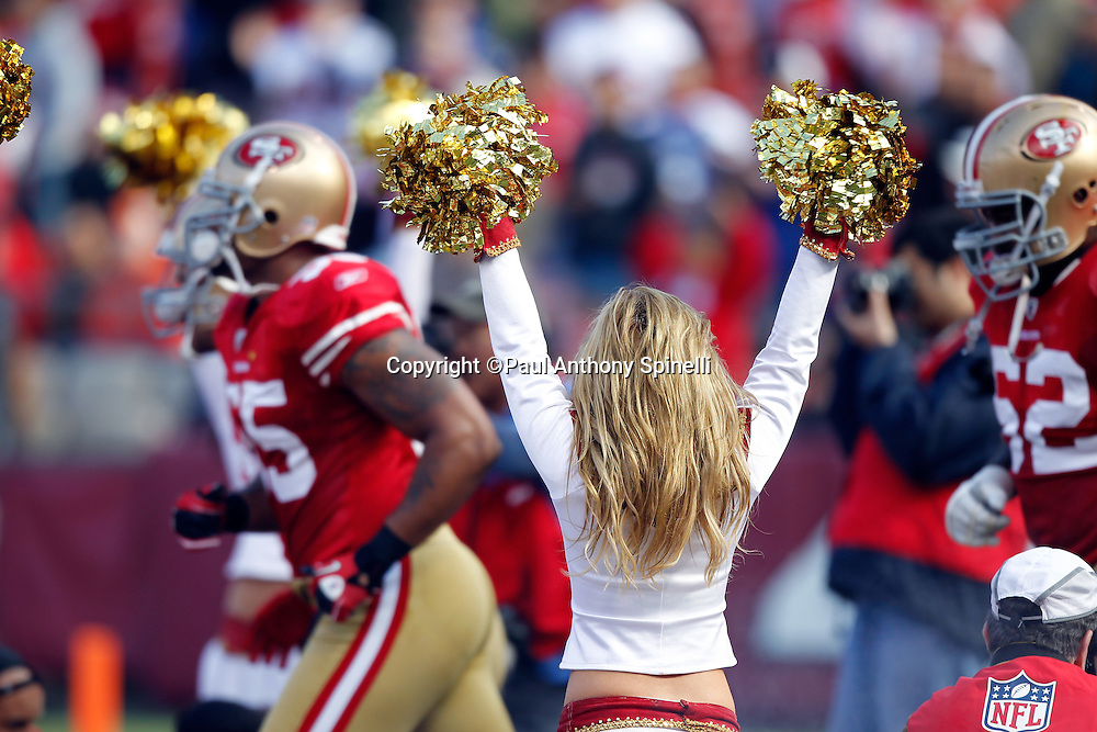 A San Francisco 49ers cheerleader cheers for the team during the NFL week 11 football game against the Tampa Bay Buccaneers on Sunday, November 21, 2010 in San Francisco, California. The Bucs won the game 21-0. (©Paul Anthony Spinelli)
