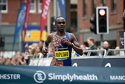 © Licensed to London News Pictures . 19/05/2019. Manchester, UK. Ugandan runner JACOB KIPLIMO wins the men's elite race . Participants take part in the Great Manchester Run in Manchester City Centre . Photo credit : Joel Goodman/LNP