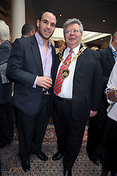 Left to right, ruby player MARK ROBINSON and Mayor of Runnymede Councillor JIM BROADHEAD at 'Lunch for Life' in aid of Marie Curie Cancer Care held at Wentworth Golf Club, Berkshire on 2nd march 2009.