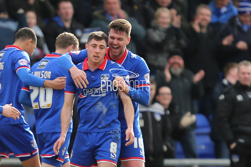 Mike Jones of Oldham Athletic celebrates his goal with Anthony Gerrard of Oldham Athletic which made the score 1-0 during the Sky Bet League 1 match between Oldham Athletic and Chesterfield at Boundary Park, Oldham, England on 28 March 2016. Photo by Simon Brady.