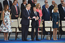 US President Donald Trump, First Lady Melania Trump and French President Emmanuel Macron with Brigitte Macron attend the annual Bastille Day military parade on the Champs-Elysees avenue in Paris on July 14, 2017. Photo by Lionel Hahn/ABACAPRESS.com