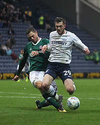 Henrik Dalsgaard of Brentford (L) appears to foul Tom Barkhuizen of Preston North End in the penalty area - Mandatory by-line: Jack Phillips/JMP - 28/10/2017 - FOOTBALL - Deepdale - Preston, England - Preston North End v Brentford - Football League Championship