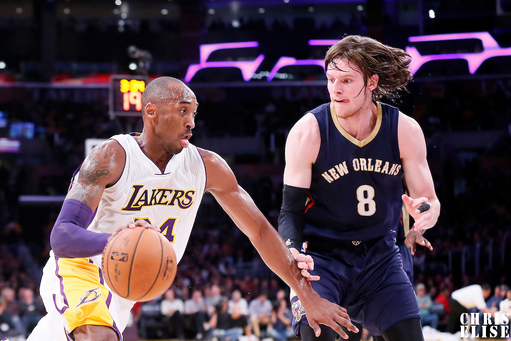 07 December 2014: Los Angeles Lakers guard Kobe Bryant (24) drives past New Orleans Pelicans forward Luke Babbitt (8) during the New Orleans Pelicans 104-87 victory over the Los Angeles Lakers, at the Staples Center, Los Angeles, California, USA.