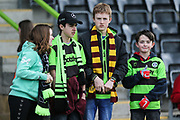 Young FGR supporters during the EFL Sky Bet League 2 match between Forest Green Rovers and Macclesfield Town at the New Lawn, Forest Green, United Kingdom on 13 April 2019.