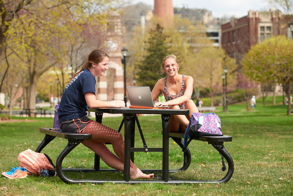 Activity; Studying; Drake Field; Location; Outside; Objects; Computer; People; Student Students; Spring; April; Time/Weather; sunny; Type of Photography; Candid; UWL UW-L UW-La Crosse University of Wisconsin-La Crosse; Woman Women Sarah Jacobs therapeutic recreation<br /> Casey Boehm education major  library
