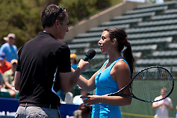 July 30, 2011; Stanford, CA, USA;  Marion Bartoli (FRA), right, addresses the crowd after winning her match against Dominka Cibulkova (SVK), not pictured, during the semifinals of the Bank of the West Classic women's tennis tournament at the Taube Family Tennis Stadium. Cibulkova retired with an injury before the match began.