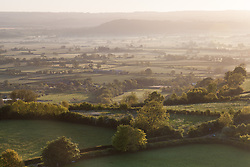 © Licensed to London News Pictures. 20/05/2015. Glastonbury, UK. Somerset Countryside. Sunrise from Glastonbury Tor this morning, 20th May 2015. The day has started off clear, with early morning temperatures near freezing in places in the south west of England. Photo credit : Rob Arnold/LNP