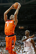 FAYETTEVILLE, AR - NOVEMBER 30:  Michael Carter-Williams #1 of the Syracuse Orangemen drives past BJ Young #1 of the Arkansas Razorbacks at Bud Walton Arena on November 30, 2012 in Fayetteville, Arkansas.  The Orangemen defeated the Razorbacks 91-82.  (Photo by Wesley Hitt/Getty Images) *** Local Caption *** Michael Carter-Williams; BJ Young