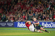 Toby Faletau (Lions) slides into Bryce Hegarty (Rebels) during the tour match of the 2013 British And Irish Lions Australian Tour between RaboDirect Melbourne Rebels vs British And Irish Lions at AAMI Park, Melbourne, Victoria, Australia. 25/06/0213. Photo By Lucas Wroe