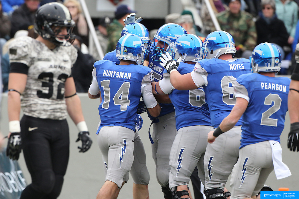Garret Griffin, Air Force, is congratulated by team mates after scoring the first of his two touchdowns, during the Army Black Knights Vs Air Force Falcons, College Football match at Michie Stadium, West Point. New York. Air Force won the game 23-6. West Point, New York, USA. 1st November 2014. Photo Tim Clayton