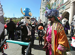 09 February 2016. New Orleans, Louisiana.<br /> Mardi Gras Day. Walking with Skeletons. The Skeleton Krewe meet before sunrise and walk 5 miles from Uptown, making their way along St Charles Avenue and into the French Quarter where they celebrate Mardi Gras Day. The Krewe reaches Jackson Square.<br /> Photo©; Charlie Varley/varleypix.com