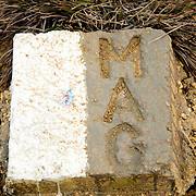 A Military Assistance Group (MAG) marker denoting a safe path amongst the stone jars at Site 1 in the Plain of Jars. The bombing by the US Air Force of the region between 1964 and 1973 has left a legacy of a large number of unexploded munitions (UXO) that groups such as MAG are helping to clear.