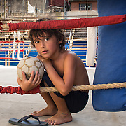 Havana, Cuba boxing gym with little boy playing.<br />