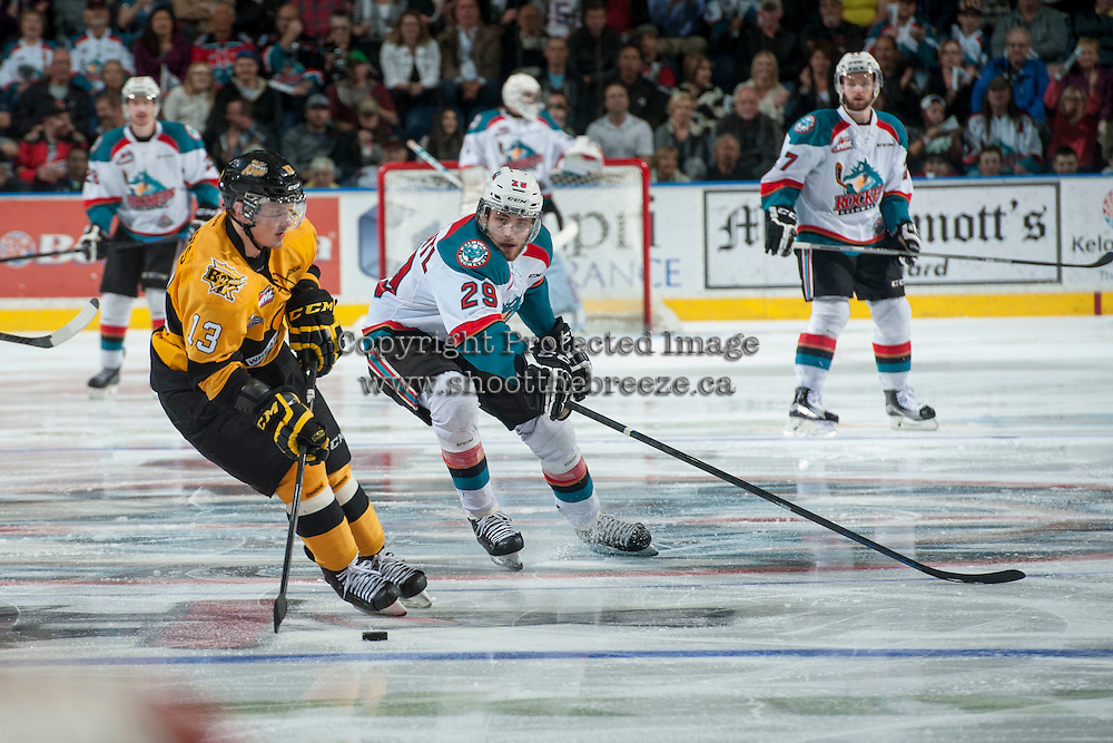 KELOWNA, CANADA - MAY 13: Leon Draisaitl #29 of Kelowna Rockets stick checks Rihards Bukarts #13 of Brandon Wheat Kings on May 13, 2015 during game 4 of the WHL final series at Prospera Place in Kelowna, British Columbia, Canada.  (Photo by Marissa Baecker/Shoot the Breeze)  *** Local Caption *** Leon Draisaitl; Rihards Bukarts;