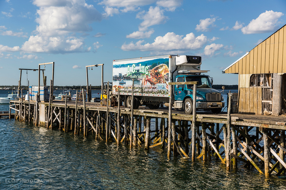 Seafood distributor A.C. Inc., based in beals, Maine, picks up a shipment of fresh lobster from the wharf at Great Wass Lobster.