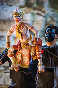 13 JANUARY 2013 - BANGKOK, THAILAND:  Puppeteers manipulate a puppet of Hanuman, the Monkey God, while performing a scene from the Ramayana at an performance space in the Bang Luang neighborhood of Bangkok. The Bang Luang neighborhood lines Khlong (Canal) Bang Luang in the Thonburi section of Bangkok on the west side of Chao Phraya River. It was established in the late 18th Century by King Taksin the Great after the Burmese sacked the Siamese capital of Ayutthaya. The neighborhood, like most of Thonburi, is relatively undeveloped and still criss crossed by the canals which once made Bangkok famous. It's now a popular day trip from central Bangkok and offers a glimpse into what the city used to be like.     PHOTO BY JACK KURTZ