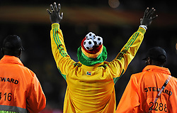 A jubilant Ghana fan is escorted off the pitch during the 2010 FIFA World Cup South Africa Group D match between Serbia and Ghana at Loftus Versfeld Stadium on June 13, 2010 in Pretoria, South Africa.