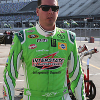 Sprint Series driver Kyle Busch walks to his hauler after the 57th Annual NASCAR Coke Zero 400 practice session at Daytona International Speedway on Friday, July 3, 2015 in Daytona Beach, Florida.  (AP Photo/Alex Menendez)