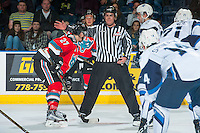 KELOWNA, CANADA - OCTOBER 14: Linesman, Kevin Crowell, stands at the face-off between Calvin Thurkauf #27 of Kelowna Rockets and the Saskatoon Blades on October 14, 2016 at Prospera Place in Kelowna, British Columbia, Canada.  (Photo by Marissa Baecker/Shoot the Breeze)  *** Local Caption *** Kevin Crowell; Calvin Thurkauf;