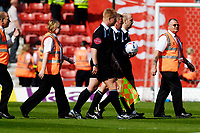 Photo: Alan Crowhurst.<br />Southampton v Leeds United. Coca Cola Championship. 21/04/2007. The officials are escorted off the pitch at half time.