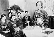 Geisha undergoing training. Photograph late 19th century. Geisha, Japanese courtesans and entertainers.