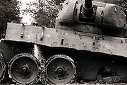 A Soviet tank which has lay in the grounds of a school for 30 years is cut up to be sold for scrap. Savannakhet, southern Laos.