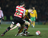 Doncaster - Friday January 30th 2009:Wes Hoolahan of Norwich City & Sam Hird of Doncaster Rovers in action during the Coca Cola Championship Match at The Keepmoat Stadium Doncaster. (Pic by Steven Price/Focus Images)