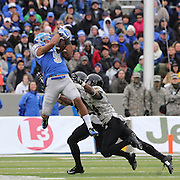 Air Force wide receiver Jale Robinette makes spectacular catch as Chris Carnegie, (right), Army, moves in to tackle  during the Army Black Knights Vs Air Force Falcons, College Football match at Michie Stadium, West Point. New York. Air Force won the game 23-6. West Point, New York, USA. 1st November 2014. Photo Tim Clayton