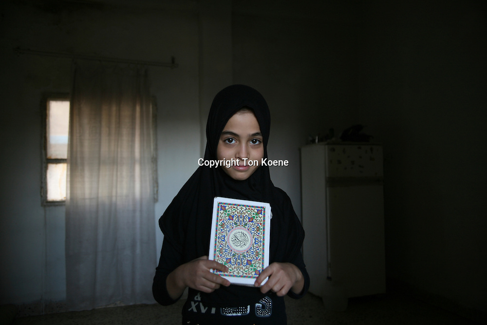 Refugee girl from Iraq in Amman, JordanMosque on friday in Amman, Jordan