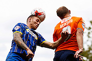 Paul Benson of Luton Town is beaten in the air by Sean Rigg of AFC Wimbledon during the Sky Bet League 2 match at Kenilworth Road, Luton<br /> Picture by David Horn/Focus Images Ltd +44 7545 970036<br /> 16/08/2014