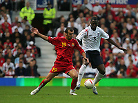 Photo: Andrew Unwin.<br />England v Macedonia. UEFA European Championships 2008 Qualifying. 07/10/2006.<br />England's Ledley King (R) looks to hold off Macedonia's Goran Pandev (L).